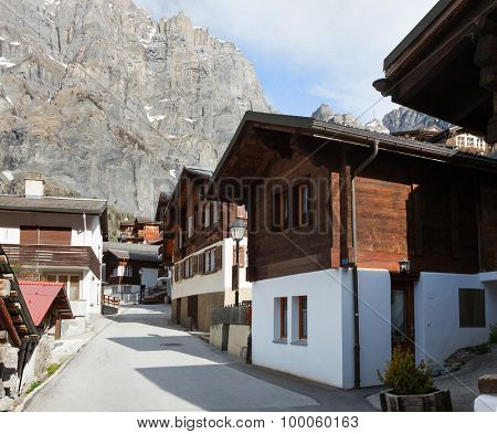 Old street  with typical swiss house in Leukerbad, Canton of Valais in Switzerland.