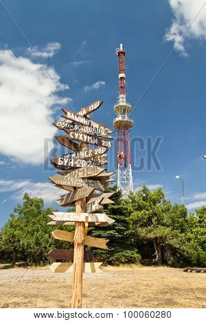 Signpost On The Background Of Telecommunication Tower