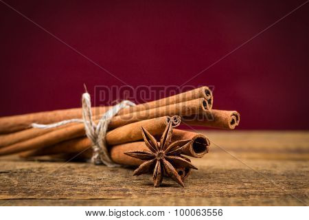 Close Up Of Cinnamon Sticks And Star Anise On Wood