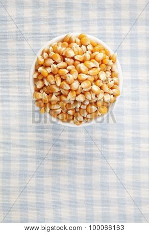 top view of maize corn on the checker mat
