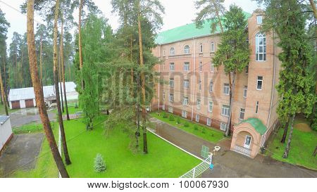 MOSCOW - MAY 29, 2015: Edifice of rest house Malahovka among forest at summer cloudy day. Aerial view