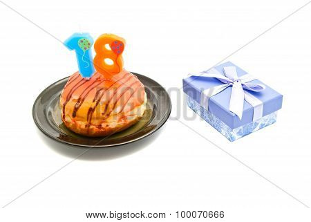 Donut With Eighteen Years Birthday Candle And Gift On White