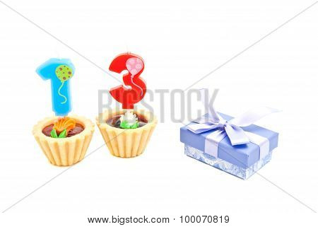 Cakes With Thirteen Years Birthday Candles And Gift On White