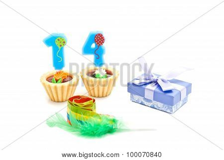 Cakes With Fourteen Years Birthday Candles, Whistle And Gift