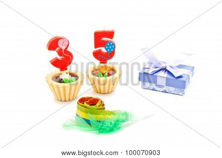 Cakes With Thirty Five Years Birthday Candles, Whistle And Gift On White