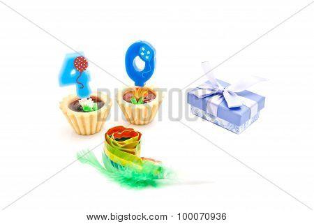 Cakes With Forty Years Birthday Candles, Whistle And Gift On White