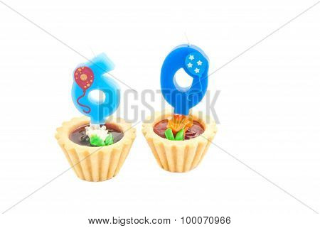 Cakes With Sixty Years Birthday Candles On White