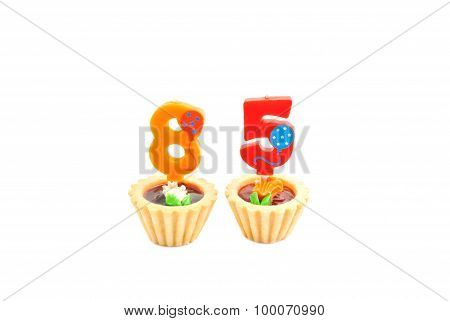 Cakes With Eighty Five Years Birthday Candles On White