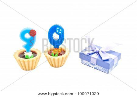 Cakes With Ninety Years Birthday Candles And Gift On White