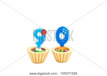 Cakes With Ninety Years Birthday Candles On White