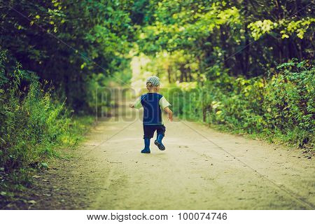 Vintage Photo Of Little Boy Running And Playing In Forest At Summer.