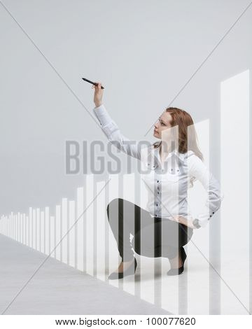 young businesswoman drawing graph with stylus