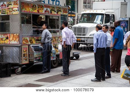 NEW YORK CITY, USA - SEPTEMBER, 2014: Businessmen during lunch at food cart