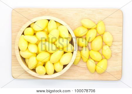 Boiled ginkgo on wooden plate, white background
