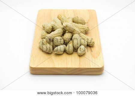 Wooden plate white peanuts on top