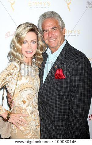 LOS ANGELES - AUG 26:  Donna Mills, Larry Gilman at the Television Academy's Daytime Programming Peer Group Reception at the Montage Hotel on August 26, 2015 in Beverly Hills, CA