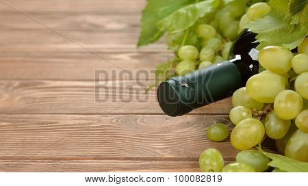 Bottle Of Wine And Grapes