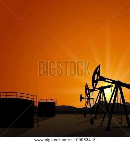 Oil pump jack for petroleum and reserve tanks on sunrise backgro