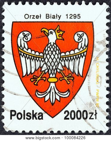 POLAND - CIRCA 1992: A stamp printed in Poland shows Arms of Poland, 1295