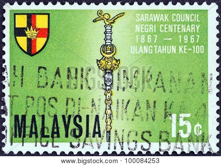 MALAYSIA - CIRCA 1967: A stamp printed in Malaysia shows Mace and Shield