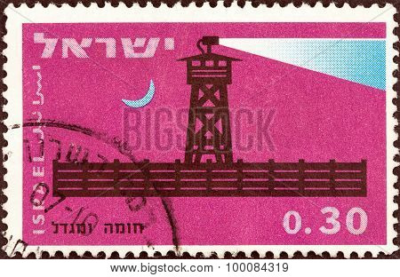 ISRAEL - CIRCA 1963: A stamp printed in Israel shows Completed stockade at night