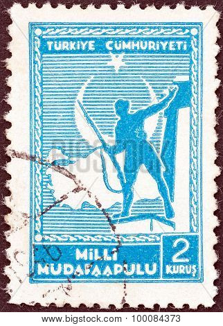 TURKEY - CIRCA 1941: A stamp printed in Turkey shows soldier and Map of Turkey, circa 1941.