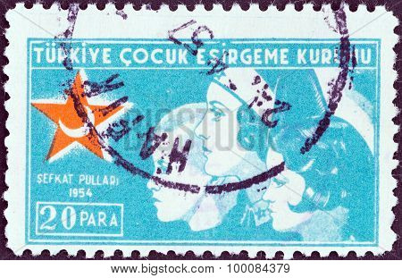 TURKEY - CIRCA 1954: A stamp printed in Turkey shows a nurse with two children