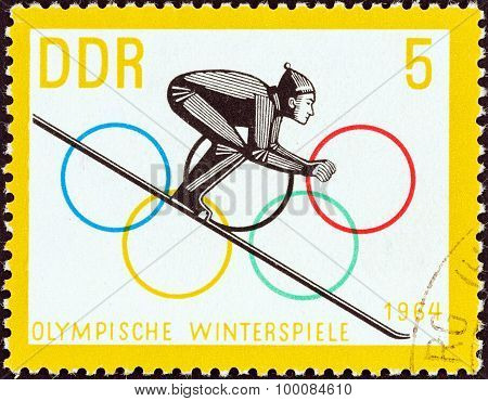 GERMAN DEMOCRATIC REPUBLIC - CIRCA 1963: A stamp printed in Germany shows Ski Jumper commencing Run