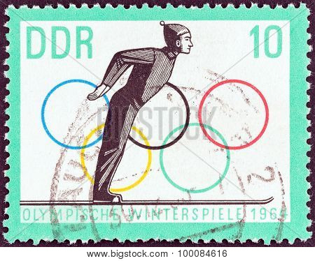 GERMAN DEMOCRATIC REPUBLIC - CIRCA 1963: A stamp printed in Germany shows Ski jumper taking off