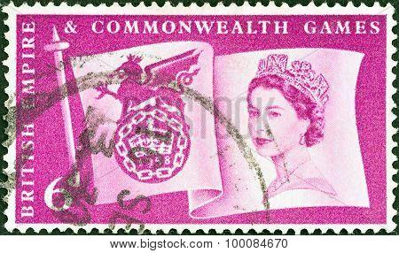 UNITED KINGDOM - CIRCA 1958: A stamp printed in United Kingdom shows Queen Elizabeth II and flag