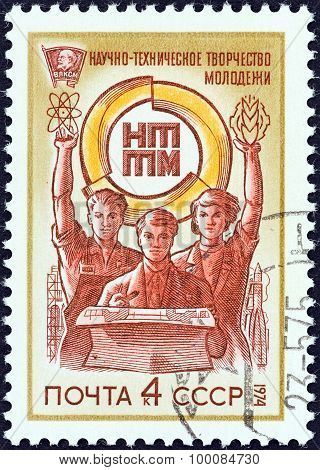USSR - CIRCA 1974: A stamp printed in USSR shows Young Workers and Emblem