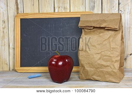 brown paper sack with apple