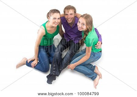 Image of smiling friends sitting on the floor