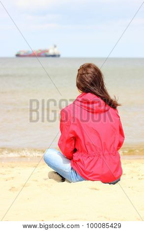 Woman Sitting On The Beach And Looks At Sea, Summer Time