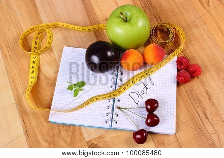 Fruits And Centimeter With Notebook, Slimming And Healthy Food