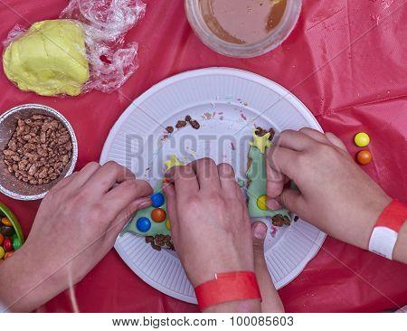 preparing Christmas colorful cookies