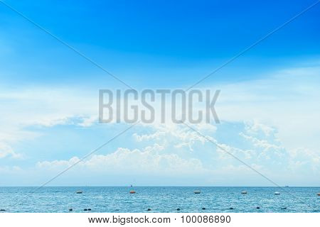 Blue Sea And Blue Sky In Cloudy Day