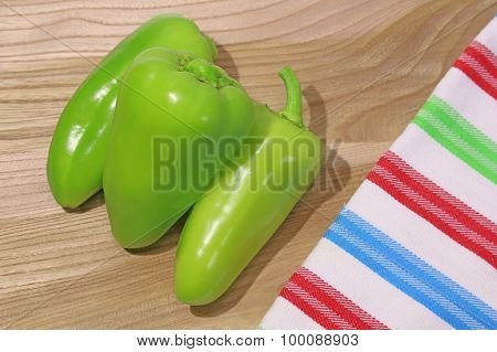 Fresh Green Ripe Peppers On Wooden Background
