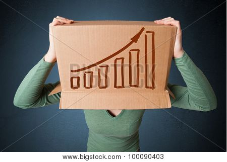Young woman standing and gesturing with a cardboard box on his head with diagram