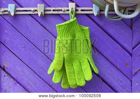 Green gloves against violet boards.