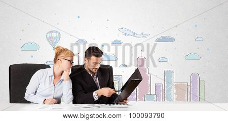 Young businessman and businesswoman with colorful city sky-scape background