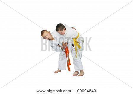 Athletes train to throw each other