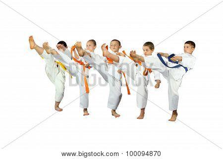 Five athletes in karategi beats mae-geri
