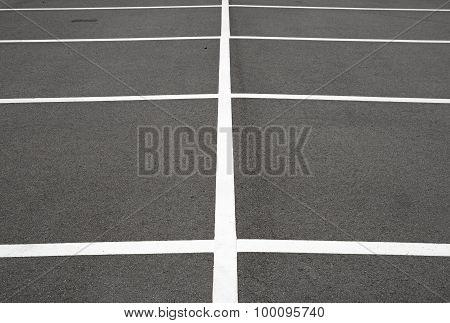 White marking lines on asphalt