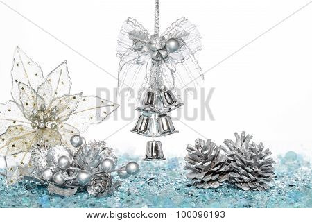 Luxury Silver Jingle Bells, Flower And Pine Cone On Snow