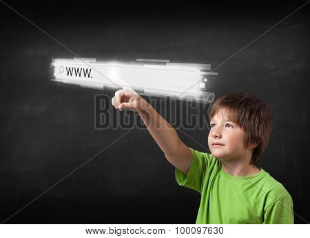 Little boy touching web browser address bar with www sign