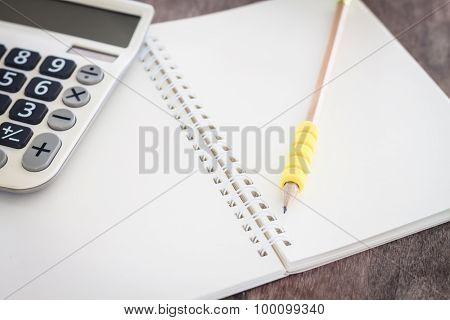 Open Blank Notebook With Pencil
