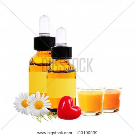 Bottles With Essence Oil, Chamomiles And Candles Isolated On White