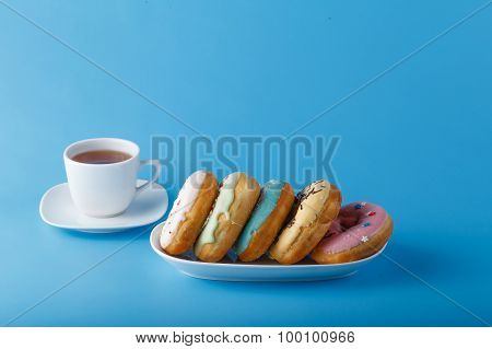 Five Donuts On Blue Background