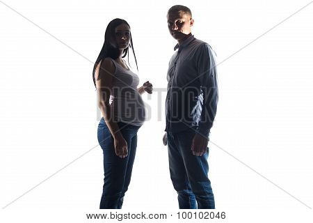 Photo pregnant woman and man in shadows